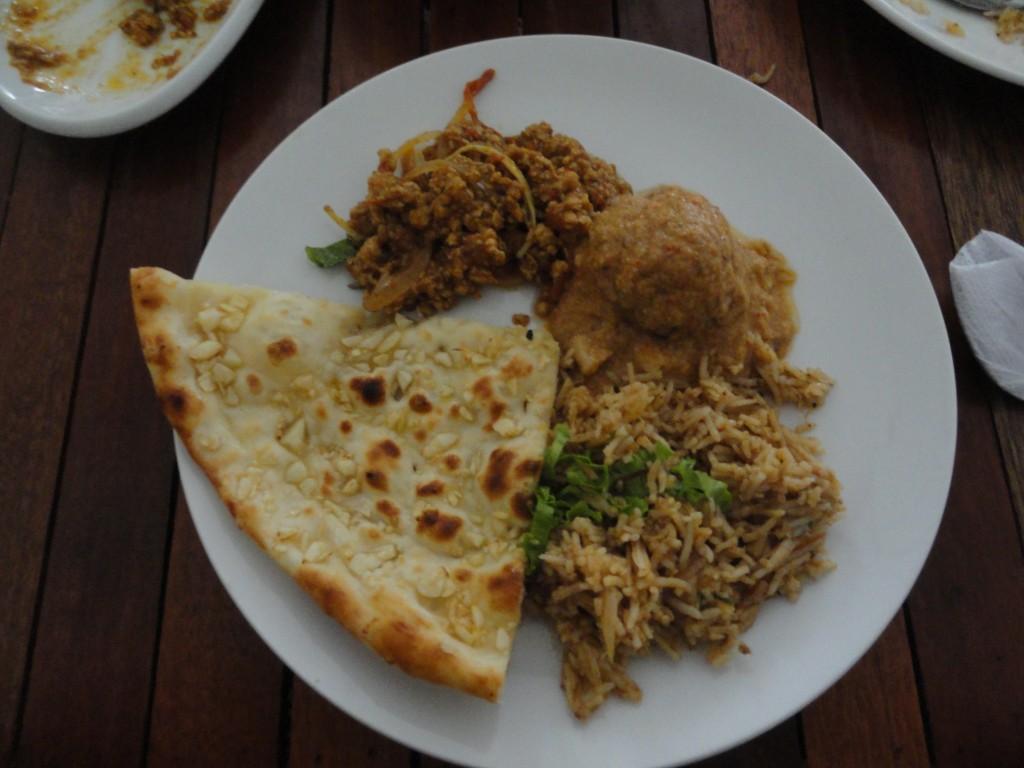 Indian food in Cambodia - Minced chicken masala, biriyani, malai kofta and naan.
